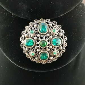Vintage silver metal round brooch with green stone